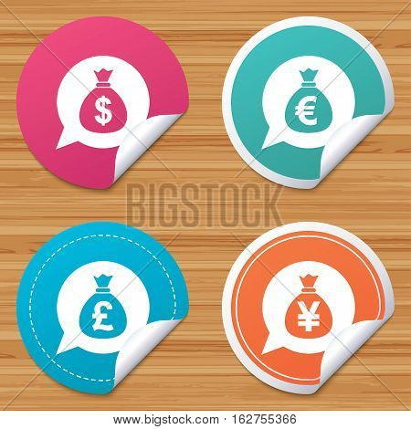 Round stickers or website banners. Money bag icons. Dollar, Euro, Pound and Yen speech bubbles symbols. USD, EUR, GBP and JPY currency signs. Circle badges with bended corner. Vector