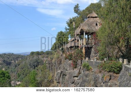 Cliff side huts at located in Huasca de Ocampo, Hidalgo, Mexico. Perfect observation point for the prisms and valley