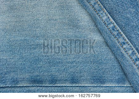 Texture of light jeans with stiches and threads background