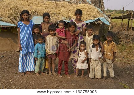 MANDU, MADHYA PRADESH, INDIA - NOVEMBER 18, 2008: Large group of children in the rural hilltop town of Mandu in Madhya Pradesh, India.