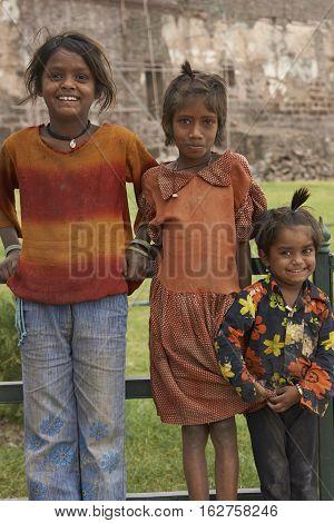 MANDU, MADHYA PRADESH, INDIA - NOVEMBER 18, 2008: Group of three children in the hilltop town of Mandu in Madhya Pradesh, India.