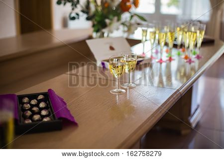 glasses of champagne on the yellow table