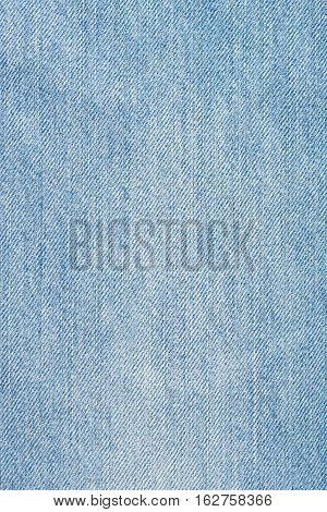Texture of light blue jeans close up. Blue jeans background