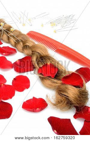Objects female hairpiece hair comb hairbrush and hairpins on a white background