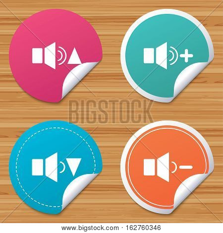 Round stickers or website banners. Player control icons. Sound louder and quieter signs. Dynamic symbol. Circle badges with bended corner. Vector