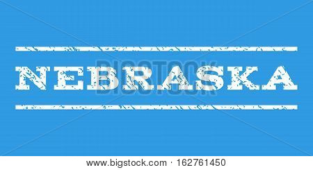 Nebraska watermark stamp. Text caption between horizontal parallel lines with grunge design style. Rubber seal stamp with dirty texture. Vector white color ink imprint on a blue background.