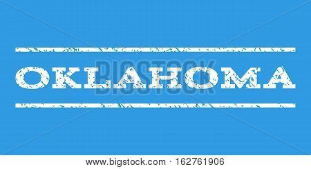 Oklahoma watermark stamp. Text caption between horizontal parallel lines with grunge design style. Rubber seal stamp with dirty texture. Vector white color ink imprint on a blue background.