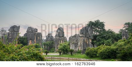 beautiful stone forest scenic national park at dusk in yunnan province China.