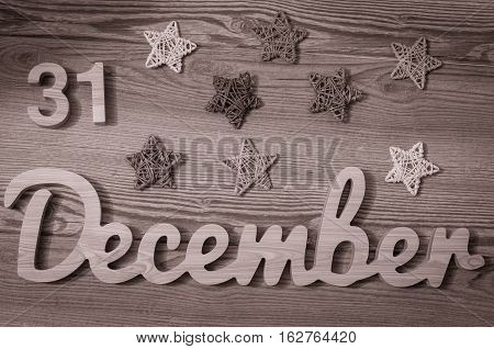 New year On Calendar. December 31. Wooden Background. 31st day of calendar last month of the year. Black and white filter.