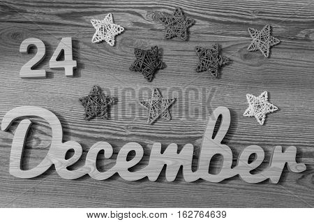 24 December date of month vintage style greeting card. Christmas eve. 24th day with vintage filter.