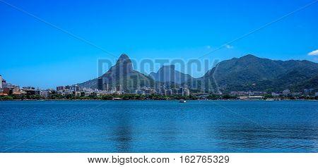 View of Rodrigo de Freitas Lagoon, Dois Irmaos Mountain and Pedra da Gavea on the background, Lagoa district, Rio de Janeiro, Brazil