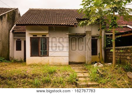 abandon house not maintained with bush and small plant grow near that in bogor indonesia java