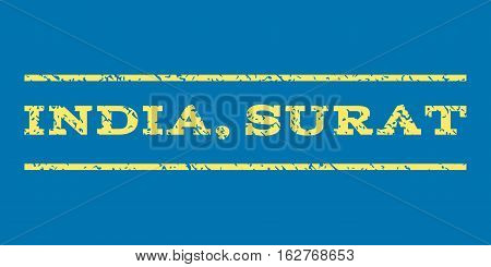 India, Surat watermark stamp. Text tag between horizontal parallel lines with grunge design style. Rubber seal stamp with unclean texture. Vector yellow color ink imprint on a blue background.