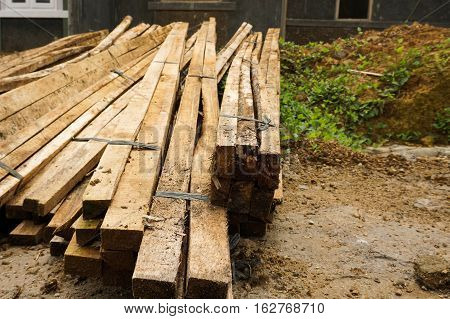a mound of plank wood used especially in building and flooring photo taken in Bogor Indonesia java