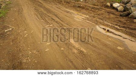 the road has not been paved photo taken in Bogor Indonesia java
