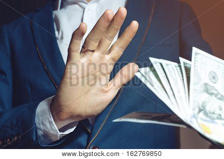 Man Businessman In Suit Refuses To Take The Bribe