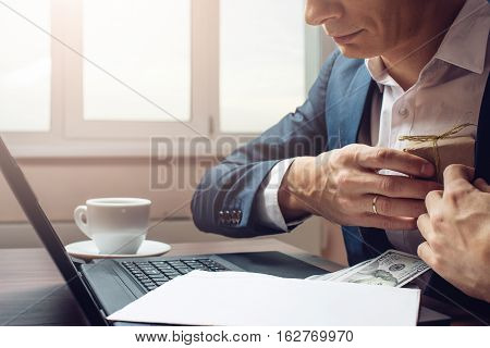 Man Businessman Taking Notes In Pocket As A Bribe