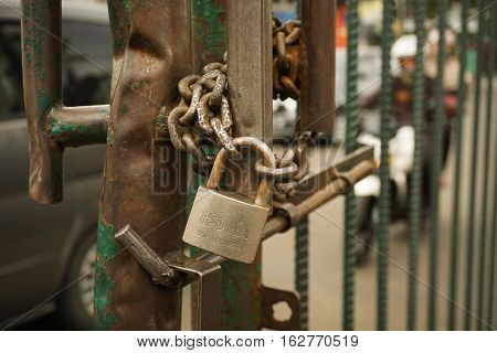 A big padlock is using to lock the gate photo taken in Bogor Indonesia java