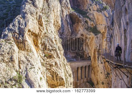 One trekker man walking along the Caminito del Rey path Malaga Spain