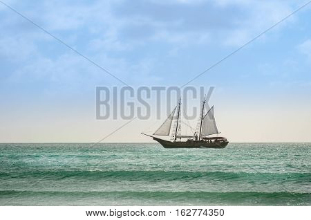Sailboat Navigating As A Background In Aruba