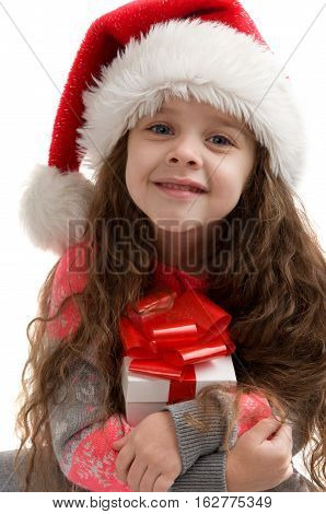 Happy small child in costume holding a box with a gift. Merry Christmas