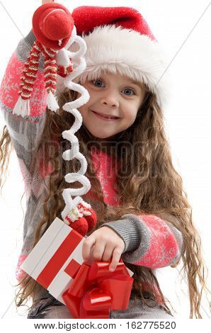 Happy small girl holding a Christmas toy. Merry Christmas. Happy New Year
