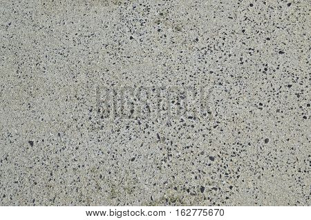 Mixed white Concrete with black stones, roadway pavement surface. Grey flat texture for 3D work, textured background