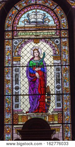 BUDAPEST, HUNGARY - JUNE 10, 2016 Saint Cahterine Stained Glass Saint Stephens Cathedral Budapest Hungary. Saint Catherine is a Christian Martyr that died in 400 AD. Cathedral built in the 1800s and consecrated in 1905.