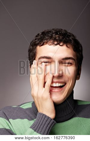 Portrait of happy man laughing and looking at camera