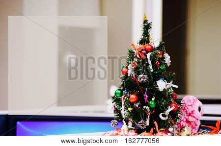 Christmas tree in office cubicles greeting card or image Closed for the holidays sign or social media community service announcement or image with room for copy for emergency number or opening office hours and logo