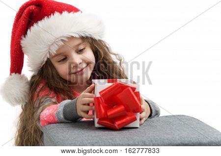 small child in costume holding a box with a gift. Merry Christmas
