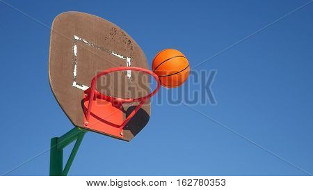 old basketball hoop, street basketball throw ball in the basket