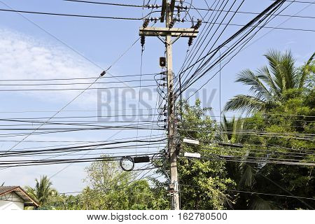 Huge number of power lines orderly running along a street in nearby Bangkok Thailand