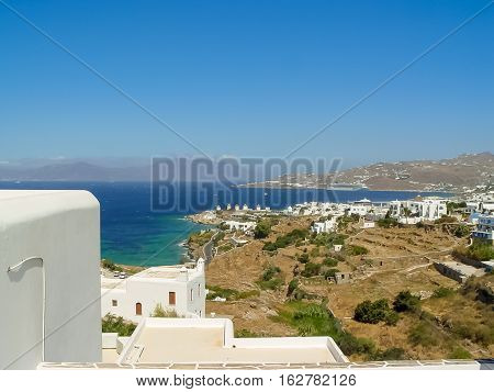 View Of Mykonos Port With Boats And Famous Windmills