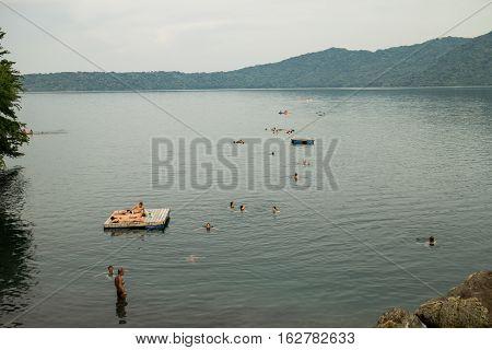 Masaya Nicaragua - June 8 2016: Tourist group swimming on Laguna de Apoyo.