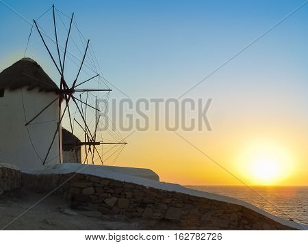 Decorative Windmills In Chora, Mykonos With Traditional Greek Architecture