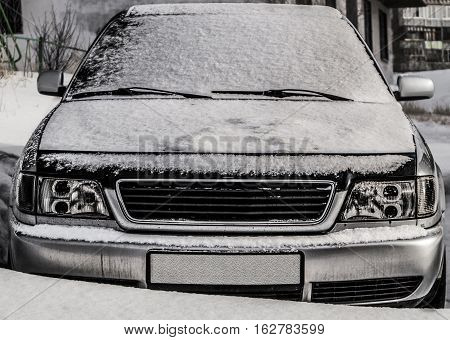 Old car, old executive car covered with snow, grunge car, used car