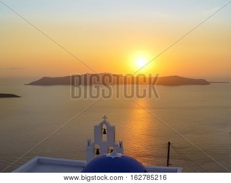 Santorini Island With Firostefani Church Against The Sunset