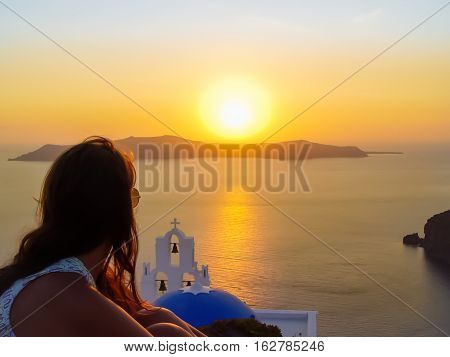 Tourist Enjoying Santorini Island With Firostefani Church