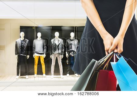 heerful shopping woman of Asian holding bags
