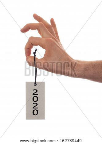 Hand Holding A Tag - New Year - 2020
