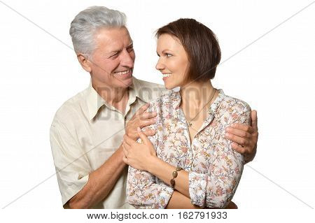 senior man with adult daughter posing against white background
