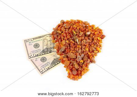 precious mineral amber and some dollars banknotes as payment