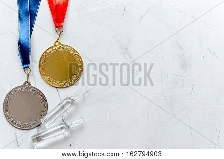 Concept of doping in sport - deprivation medals top view. poster