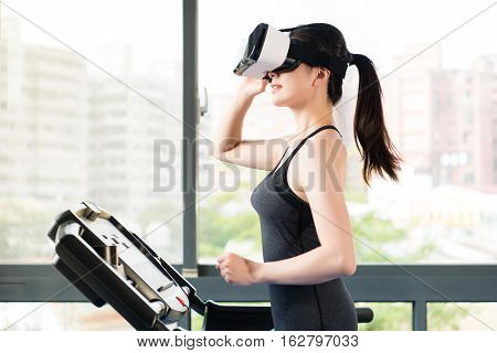 Beauty Asian Woman Running Treadmill By Vr Headset Glasses