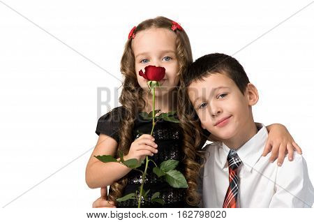 small children with flowers. a boy and a girl.