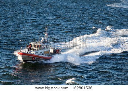 NEW YORK CITYUSA - september 20 2015: U.S. Coast Guard patrol vessel speeding through the waters off Manhattan in New York NY USA
