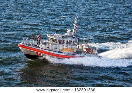 NEW YORK CITYUSA - september 20 2015: U.S. Coast Guard patrol vessel speeding through the waters off Manhattan in New York NY USA
