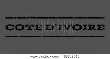 Cote D'Ivoire watermark stamp. Text tag between horizontal parallel lines with grunge design style. Rubber seal stamp with unclean texture. Vector black color ink imprint on a gray background.