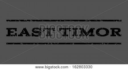 East Timor watermark stamp. Text caption between horizontal parallel lines with grunge design style. Rubber seal stamp with dust texture. Vector black color ink imprint on a gray background.